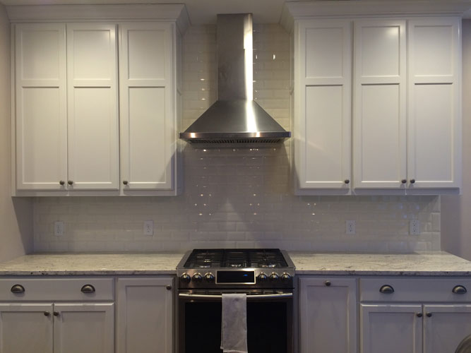 Granite surround with stovetop and hood